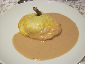 De-boned pigeon baked in a pastry crust with foie gras sauce
